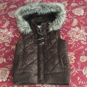 Justice puffy vest.